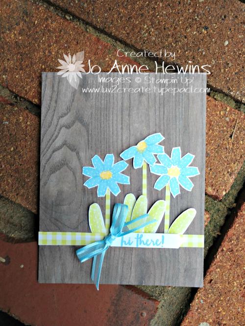 Flowering Desert Flowers in Balmy Blue by Jo Anne Hewins